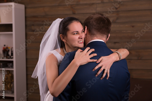 Bride embracing groom after marriage proposal Wallpaper Mural
