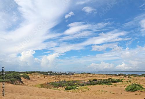 Obraz na plátně Dramatc clouds and sand dunes viewed from Jockeys Ridge State Park, Nags Head, N