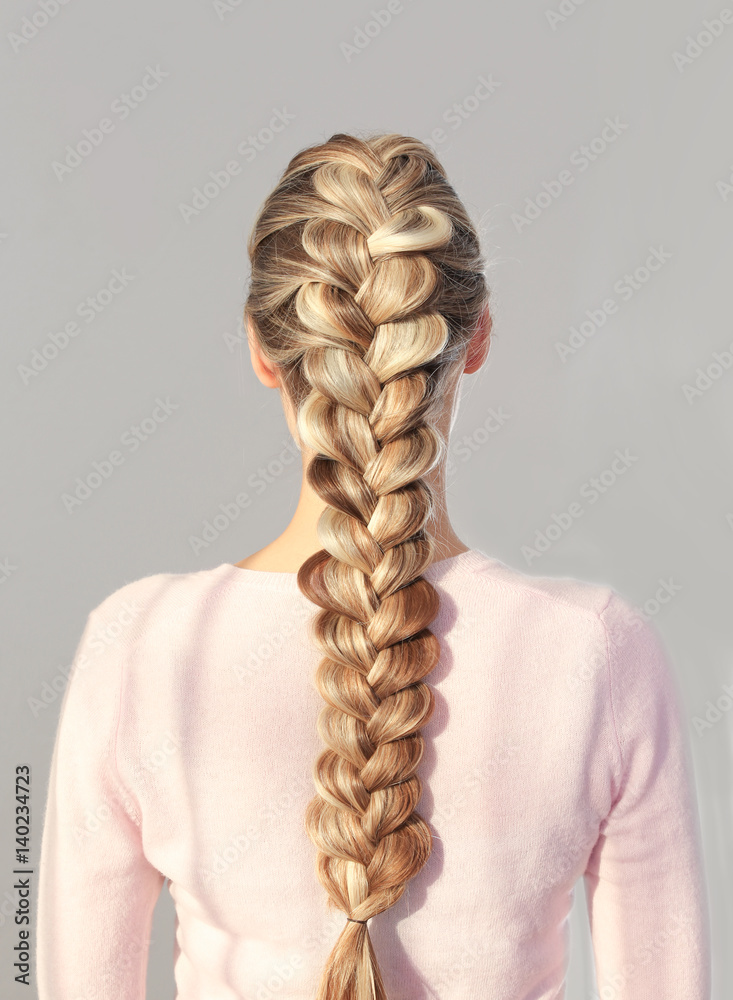 Fototapety, obrazy: Young beautiful woman with nice braid hairstyle on light background