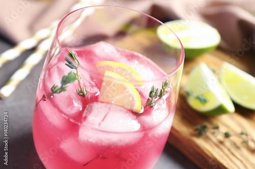 Obraz na plátně  Glass with delicious wine spritzer, closeup