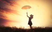 Shadow Of A Beautiful Young Woman With Umbrella On The Wonderful Sun Background