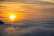 Beautiful sunrise above the fog