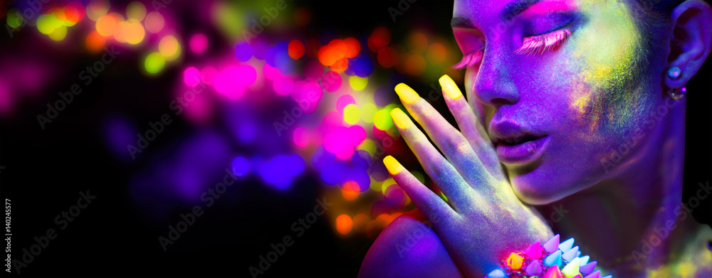 Fototapeta Beauty woman in neon light, portrait of beautiful model with fluorescent makeup