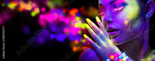 Obraz Beauty woman in neon light, portrait of beautiful model with fluorescent makeup - fototapety do salonu