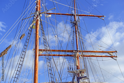 Poster Zeilen Nautical maritime scene with ropes and mast on a ship on a dock by the water