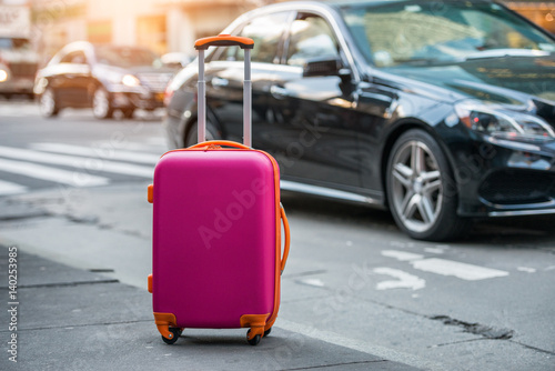 Stampa su Tela Luggage bag on the city street ready to pick by airport transfer taxy car