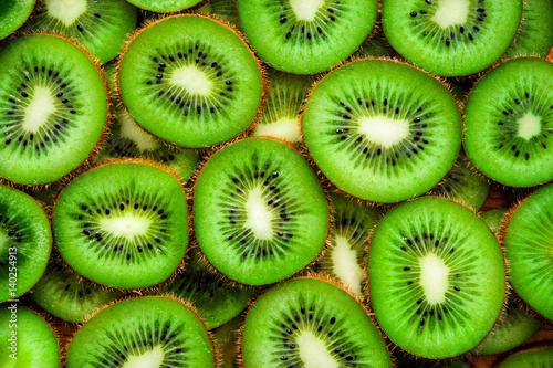 Fototapeta  Juicy green round pieces of kiwi on the surface