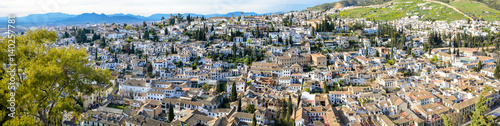 Panoramic landscape of Albaicín neighborhood in Granada. Typical Spanish village with white houses.