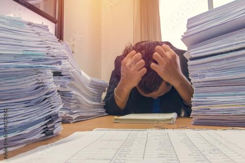 Fotografie, Obraz  documents on desk stack up high waiting to be managed