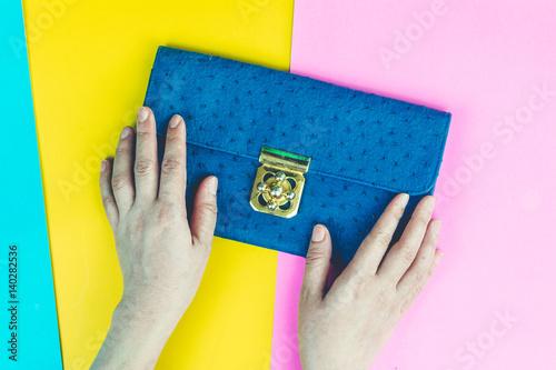 Papiers peints Cactus Woman hand holding handbag on colourful background