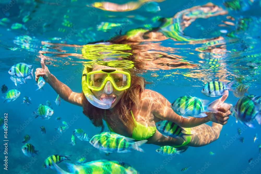 Fototapeta Happy family - girl in snorkeling mask dive underwater with fishes school in coral reef sea pool. Travel lifestyle, water sport outdoor adventure, swimming lessons on summer beach holidays with child.