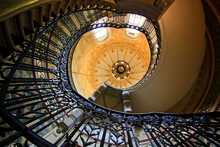 Spiral Staircase In The Hall With Stained-glass Window
