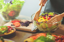 Woman Cooking Salad With Vegetables.