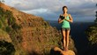 Yoga meditation - woman meditating doing yoga pose in amazing nature landscape in mountains.