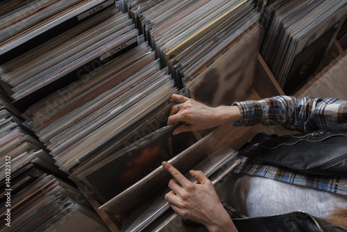 Wall Murals Music store female hands browsing vinyl records in a store