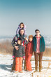 Portrait of large cute happy family in winter snow outdoors