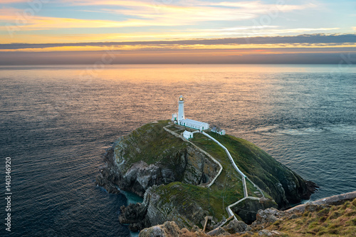 Fototapeten Leuchtturm South stack lighthouse on Holy Island in Wales at sunset