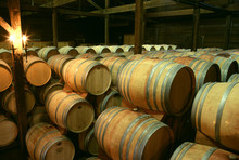 Barrels Of Wine Stacked In A Wine Cellar