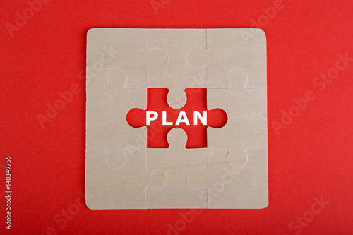 "Fotografie, Tablou  Jigsaw Puzzle Pieces with word ""Plan"" on red background"