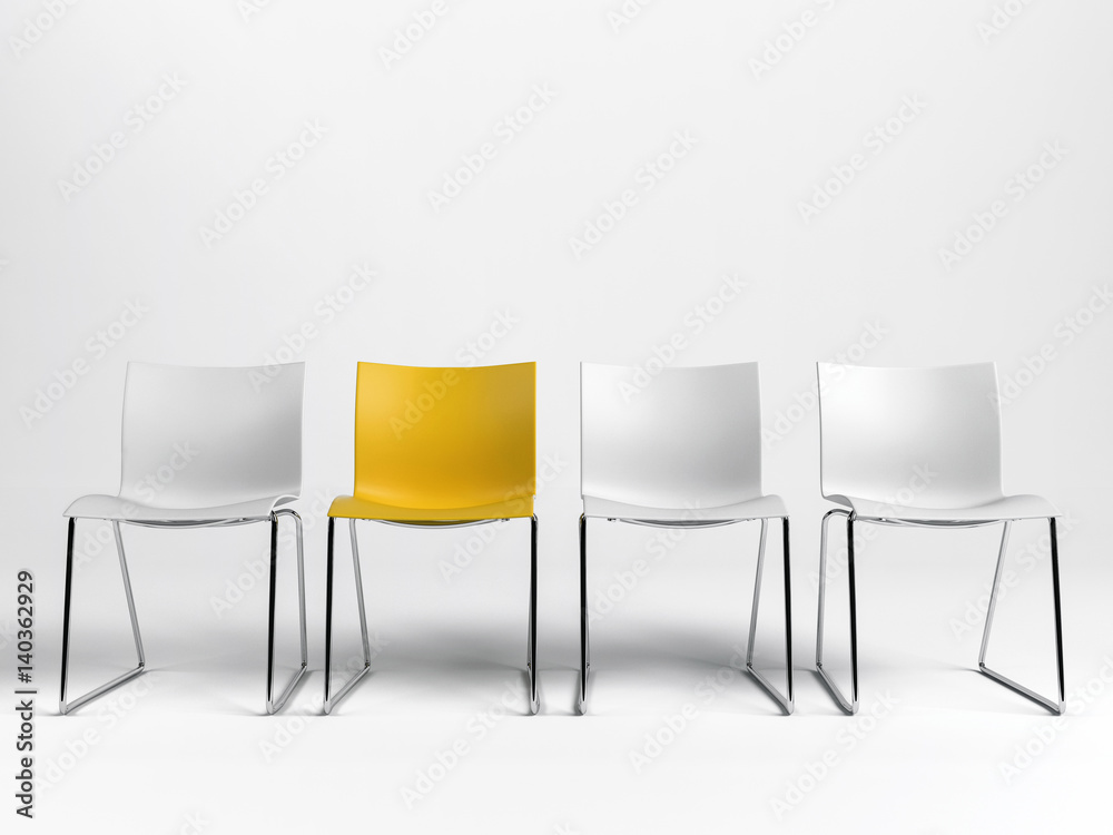 Fototapeta Line of three white and one yellow chairs