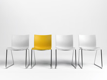 Line Of Three White And One Yellow Chairs