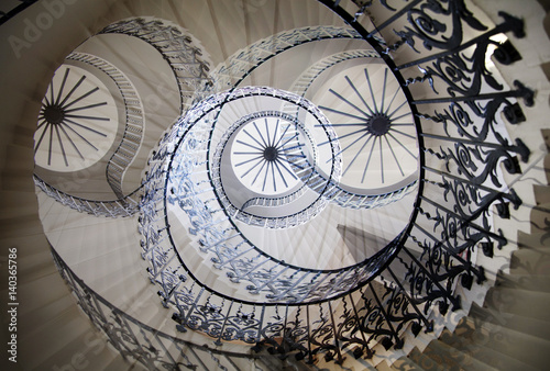 Fotografia  Multiple exposure image of spiral stairs, London. Greenwich house