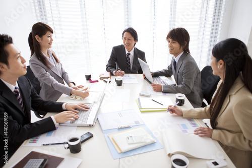 Business people talking in boardroom meeting