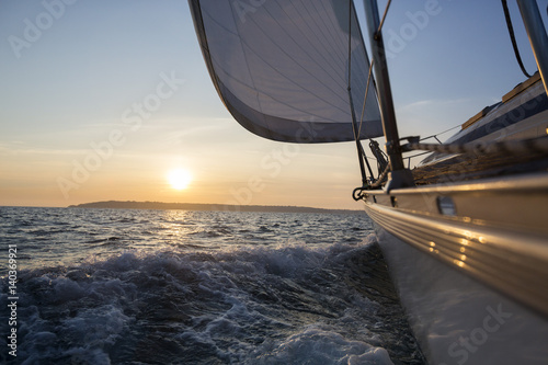 Sail Boat Sailing In Sea During Sunset