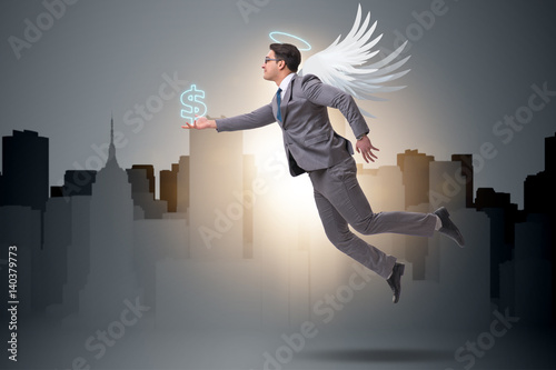 Fotografía  Angel investor concept with businessman with wings