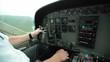 Inside small plane cockpit. Pilot flying small plane