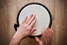 Hands Playing On Djembe Drum