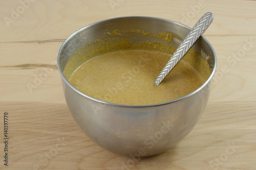Fotografie, Obraz  Mixing up gingerbread dough in stainless mixing bowl