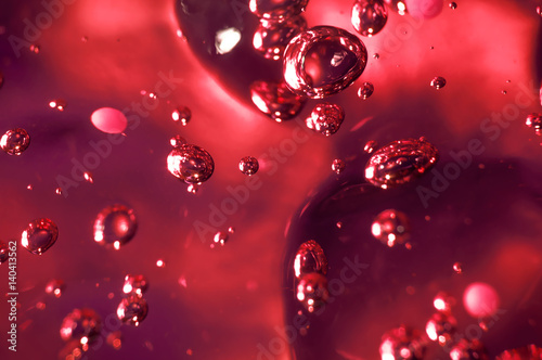 Soap bubbles on green background, abstract background.