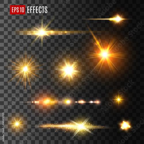 Fotografie, Obraz Gold light flash or star shine light vector icons