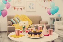 Decorated Birthday Room With Tasty Cake On Table