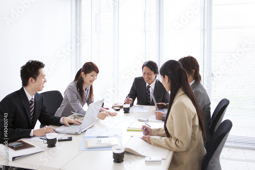 Business people talking in meeting at office