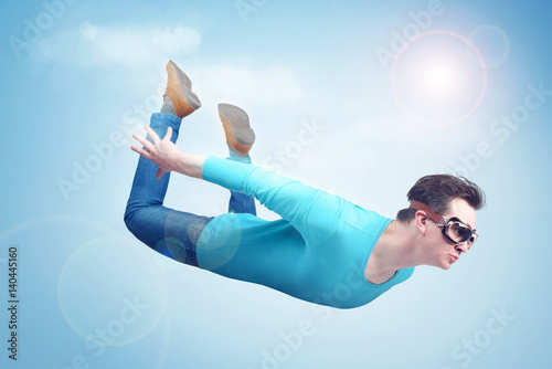 Fotografie, Obraz  Crazy man in goggles is flying in the sky. Jumper concept