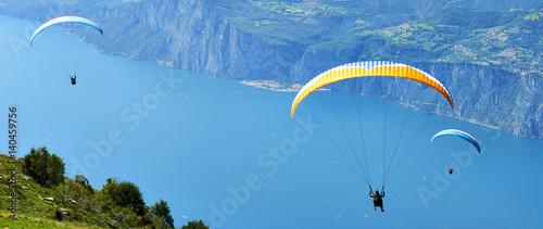 Fotografie, Obraz  Paragliding is a popular activity on Lake Garda
