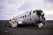 Airplane Wreckage On Black San...