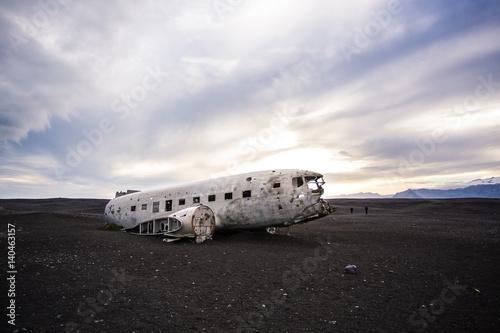 Airplane wreckage on black sand beach. Iceland Poster