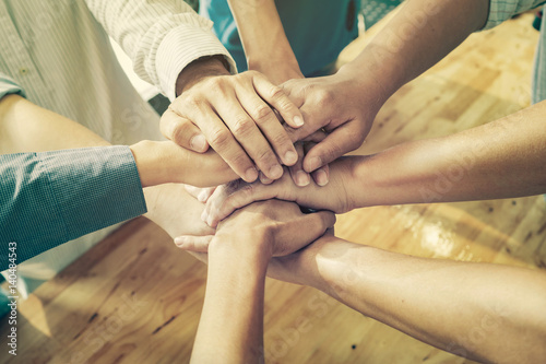Carta da parati Teamwork and Support concept,Business people team standing hands holding together in the office