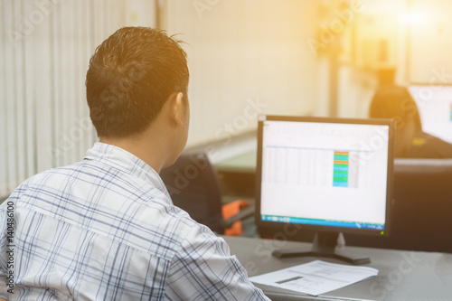back side of Worried businessman working trying to solve troubles on