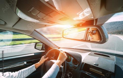 Fotografie, Obraz  Woman drive a car reflects in back view mirror