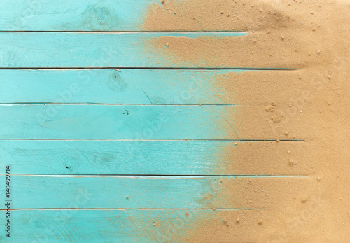 Photo  Sea sand on blue wooden floor,Top view with copy space