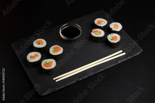 Autocollant pour porte Sushi bar Sushi of norimaki with trout and cucumber on slate plate