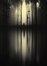 Surreal Forest Landscape With Trees And Mysterious Man Silhouette Reflecting On Lake Water Surface