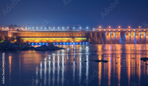 Photo sur Toile Barrage Dam at night. Beautiful industrial landscape with dam hydroelectric power station, bridge, river, city illumination reflected in water, rocks and sky. Dniper River, Zaporizhia, Ukraine.