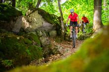 Couple Mountain Biking On Sing...
