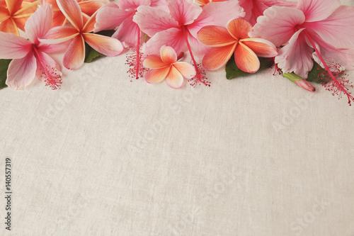 Frangipani, Plumeria, Hibiscus flowers on linen, copy space background, selective focus, vintage tone