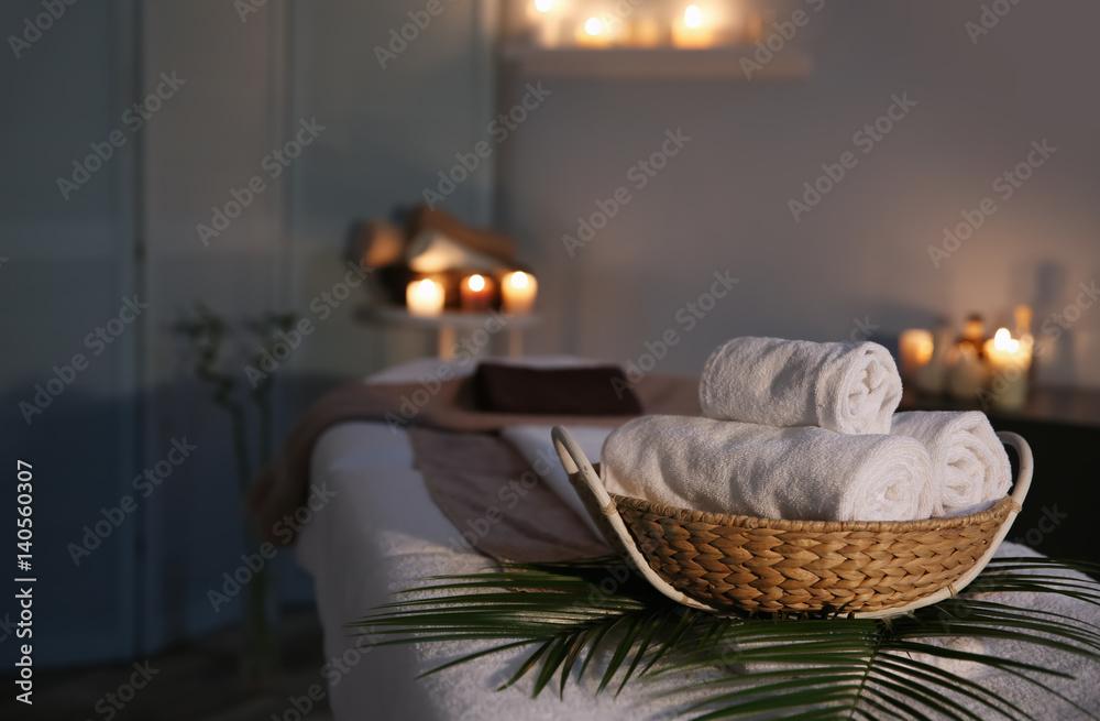 Fototapety, obrazy: Spa towels in wicker basket on massage table